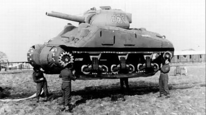 "Allied forces carry an inflatable tank as part of ""Operation Fortitude"""